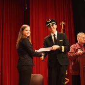 Jessica Jenkins receives her award from First Officer Logan Case