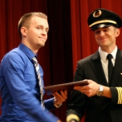Marty Dye receives his award from First Officer Logan Case