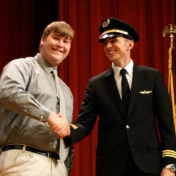 Richard Quant receives his award from First Officer Logan Case