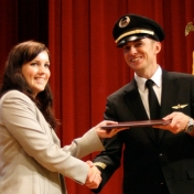 Sarah Boots receives her award from First Officer Logan Case