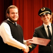 Anthony Vaught receives his award from First Officer Logan Case