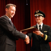 Dustin Ratliff receives his award from First Officer Logan Case