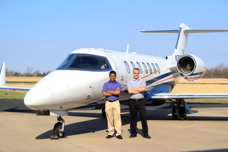 l-r: Horace Hunter and Sam Elliott with the Ward/Kraft corporate jet